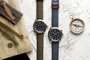 Bremont Uhren, Kompass und Zirkel auf einer Landkarte